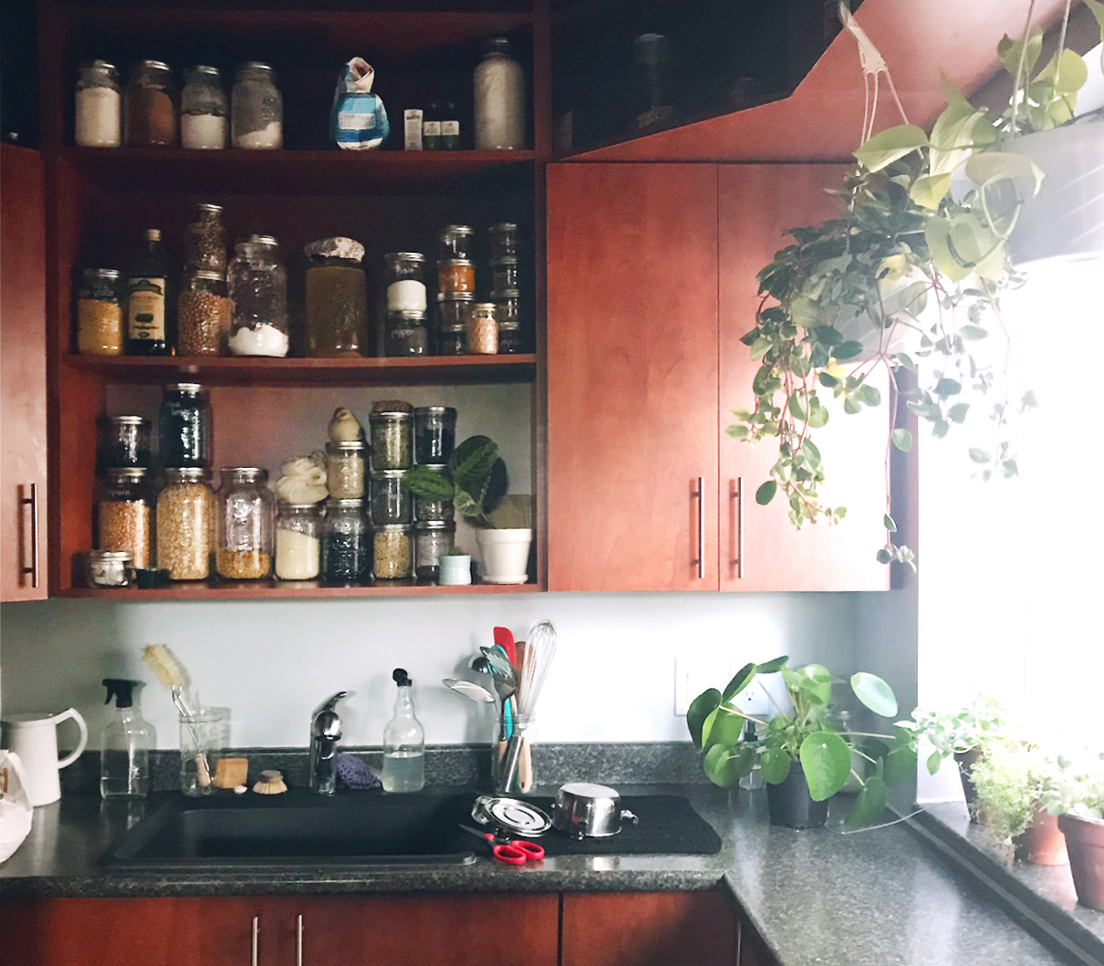 A zero waste kitchen with glass jars to store food