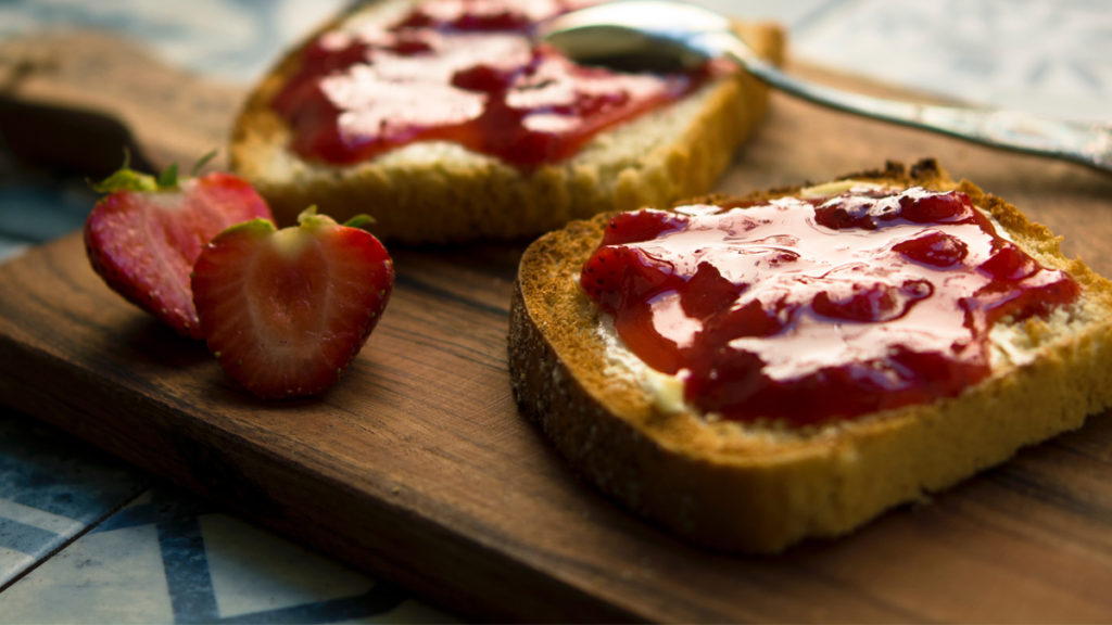Strawberry jam slathered on toast. Homemade jam is an easy eco friendly gift idea
