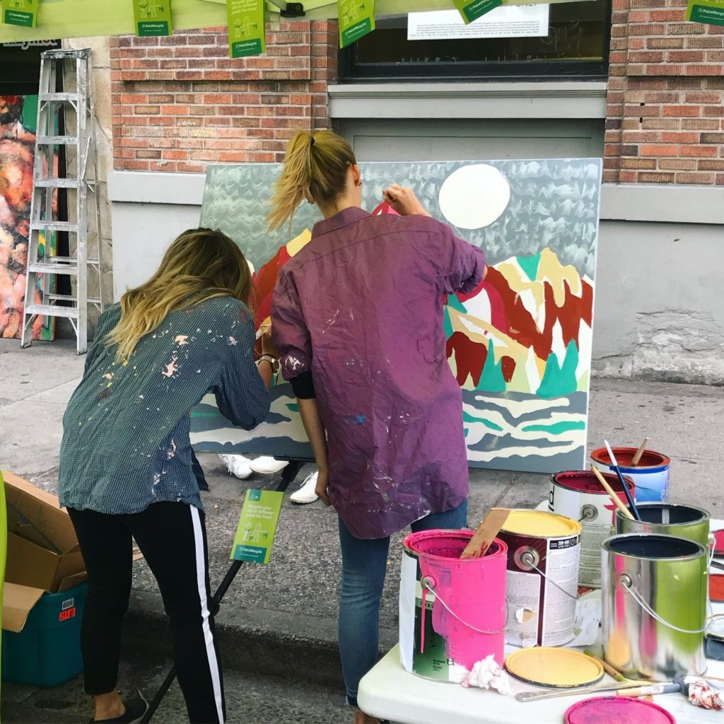 Painting a mural with recycled paint from the PaintShare program