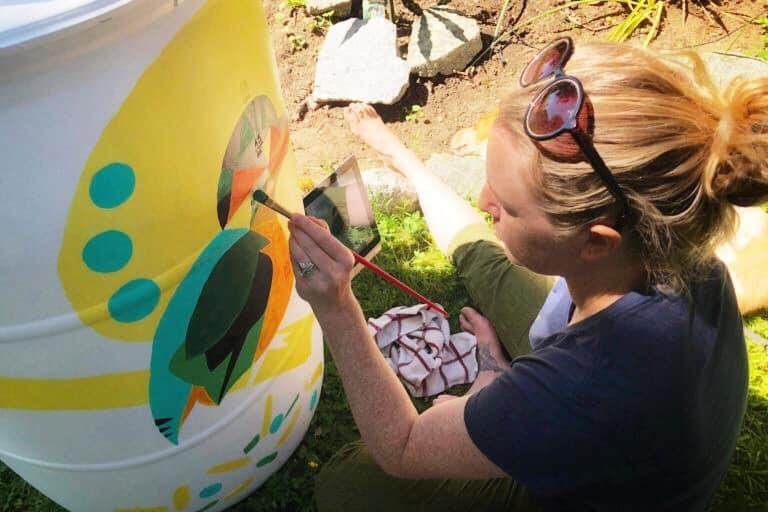 DIY rain barrel painted using leftover paint