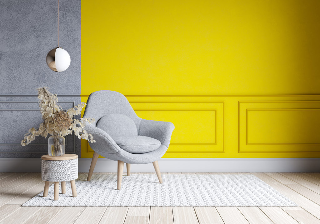 Modern living room interior design. yellow and gray paint wall with gray chair . Color of the year 2021 lighting trend