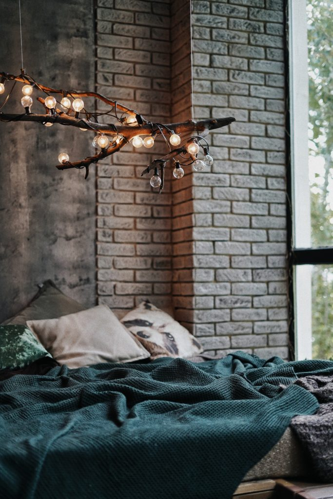 lights on branch on top of bed
