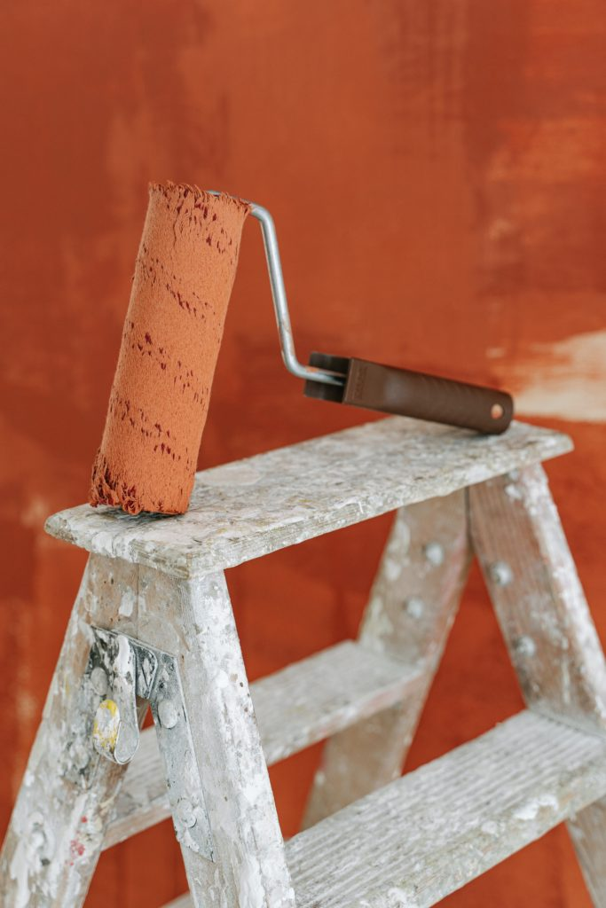 paint roller on top of ladder