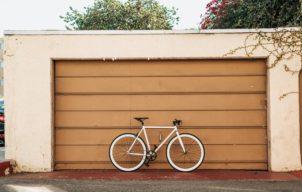 Bicycle in front of a garage door